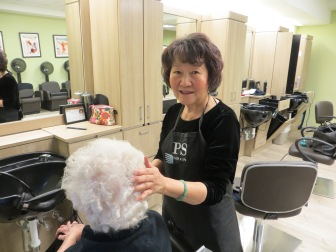 Kathy Vodinh works on a residents hair at the Lakeside Commons Salon